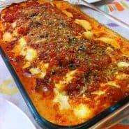 Receita de Canelone recheado de Presunto e queijo com molho branco e de tomate